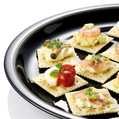 Canapes on black plate