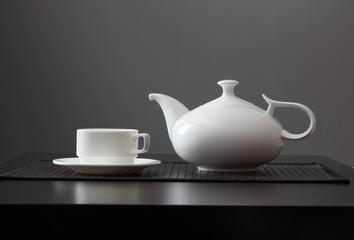 White teapot with a mug