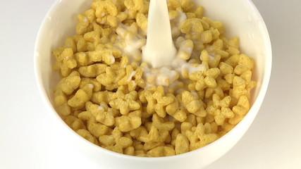 Pouring milk onto cornflakes