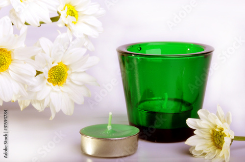 Simple white daisies and two candles with isolated white backgro