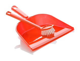 isolated red plastic dustpan and brush