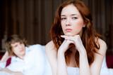 Fototapety couple in disagreement in bedroom