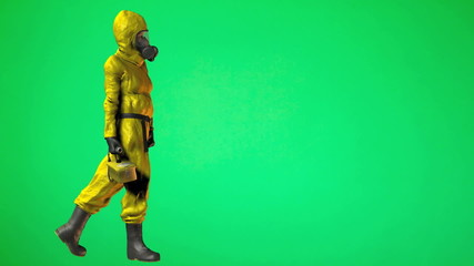 Person walking in HAZMAT Suit with geiger counter