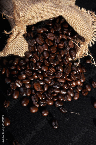 A lot of coffee outside the sackcloth isolated on the black back