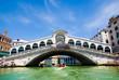 Venice Grand canal with gondolas and Rialto Bridge, Italy
