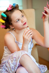 Lovely little girl making makeup