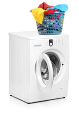 A studio shot of a laundry basket on a washing machine