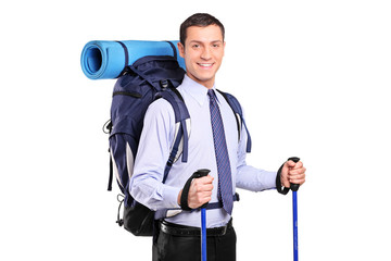 Portrait of a businessman with backpack and hiking poles