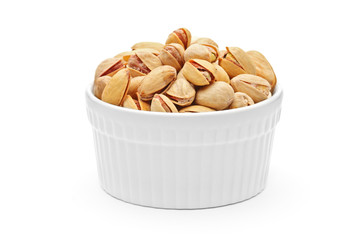 Salted and roasted pistachio nuts in a porcelain bowl