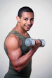 Tough smiling gym guy strength training