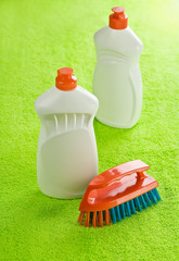 two cleaner bottles and brash