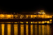 Night lights of Prague National Theater and the Vlava river quay