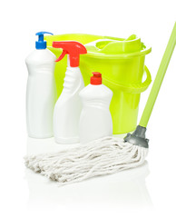bottles on a background of the bucket and mop