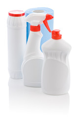three white cleaner bottle and blue towel
