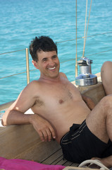 man smiling on sail boat