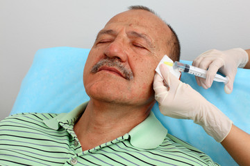 Men receiving botox injection