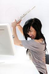 Angry woman at computer