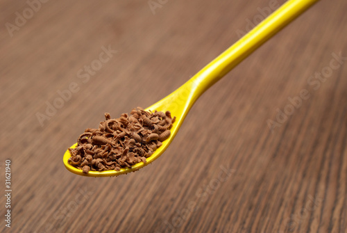 Teaspoon full of chocolate shavings