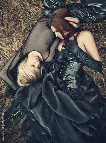 Young goth couple outdoors