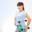 woman in fitness holding scales