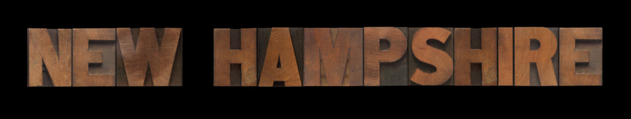 the words New Hampshire in old wood type