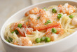 Lemony prawn and pea pasta topped with grated cheese