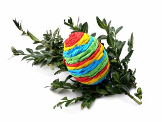 Colorful Easter egg on myrtle isolated on white
