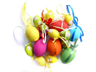Colorful Easter eggs with ribbons on white