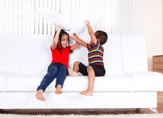 Kids playing with pillows