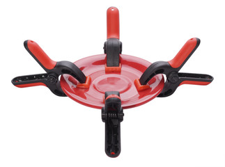 Four clamps tearing empty plate