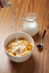 Bowl of breakfast cereal on wooden surface