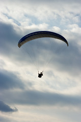 Paraglider silhouette and dramatic sky
