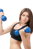 Sporty woman doing exercises with blue dumbbells weights