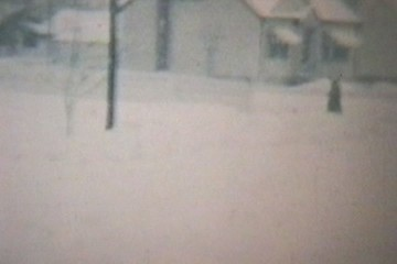 Old Car Stuck In A Snow Storm (1960 Vintage 8mm Film Stock)