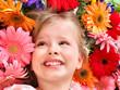 Cute child lying on  flower.