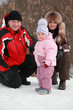 father, mother and daughter at snow, winter