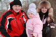 father, mother and little daughter at winter on nature