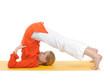 series or yoga photos. young woman in halasana pose on yellow pi