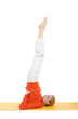 series or yoga photos. young woman in sarvangasana pose on yello