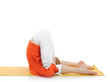 series or yoga photos. young woman in halasana pose on yellow pi