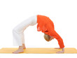 series or yoga photos. young woman in chakrasana pose on yellow