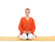 series or yoga photos. young woman in virasana pose on yellow pi