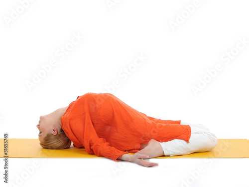 series or yoga photos. young woman in fish pose on yellow pilate