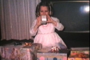 Sisters With Christmas Gifts (1974 Vintage 8mm film)