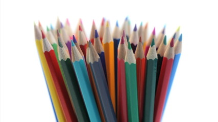 Top of color pencils turning in a pencil holder