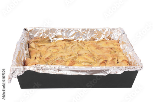 Apple pie on a baking sheet. Isolated on white