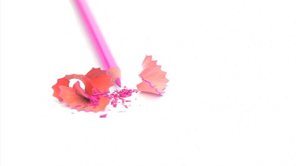 Pink pencil turning on itself