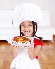 Girl holding apple pie