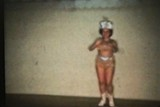 Teenage Girl Dancing With Baton (1958 Vintage 8mm film)