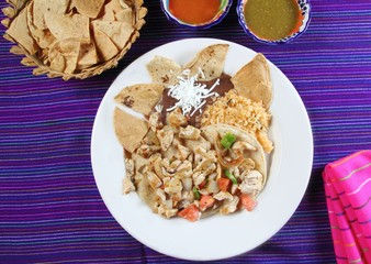 Chicken tacos Mexican style chili sauce and nachos